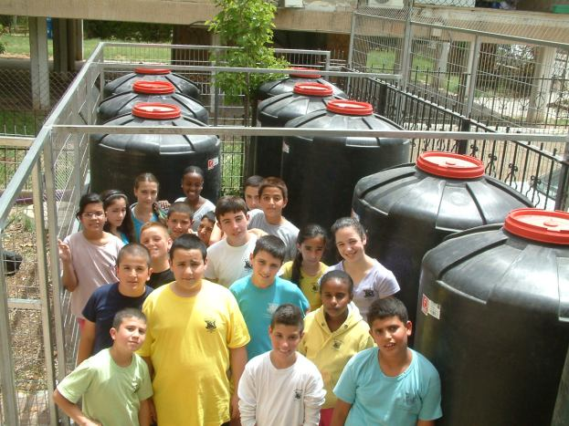 Students with rainwater harvesting system