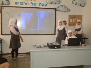 Students present data on rainwater harvesting to peers