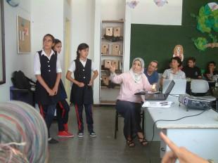 Students and teachers present data on rainwater harvesting