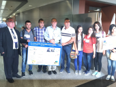 Student group from Shaeb Junior High School present poster project to visiting Rotarians.