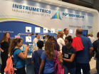 Students visit WATEC Conference exhibits and ask questions in order to help them design their poster project.
